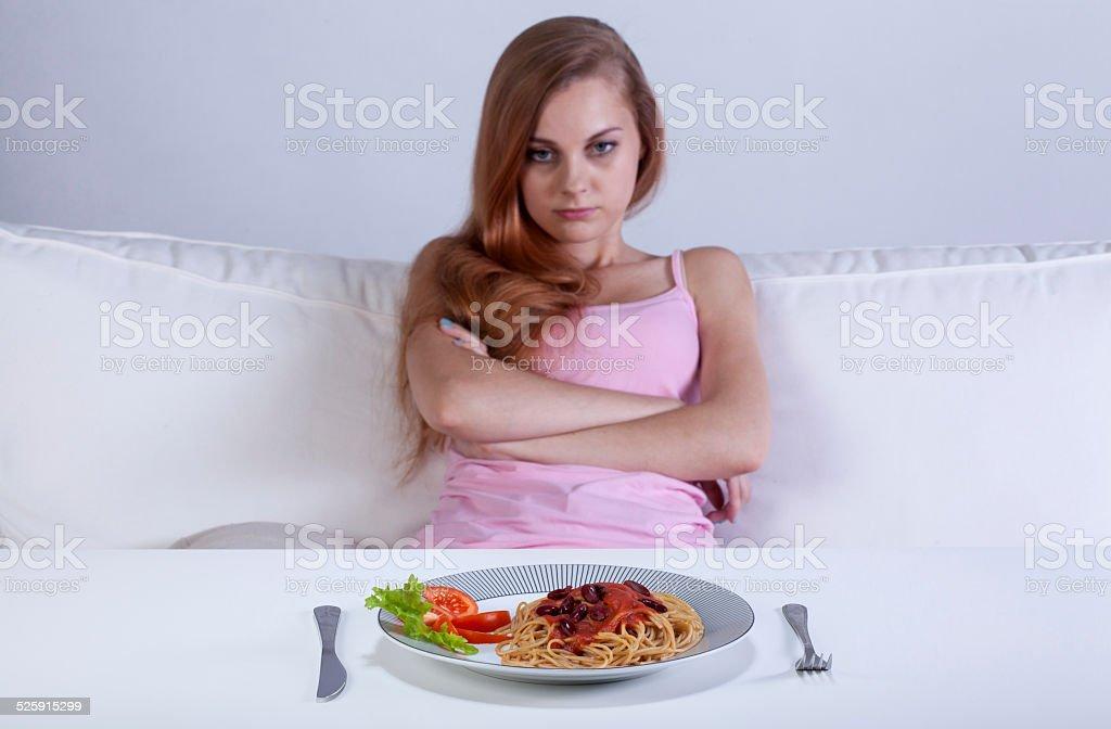 Girl refusing to eat dinner stock photo