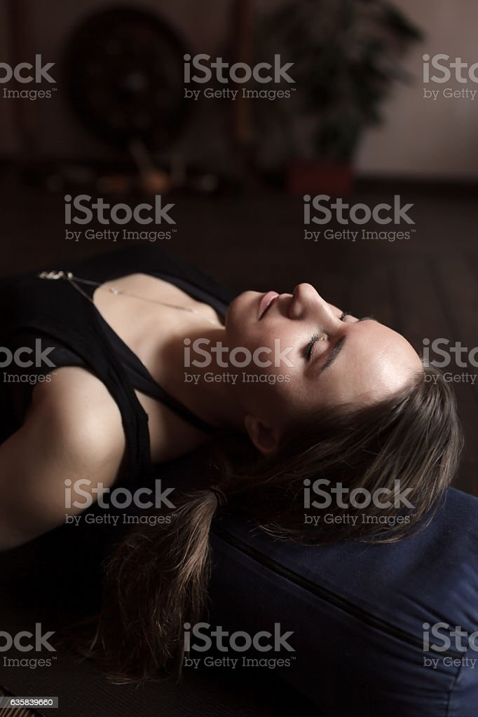 Girl relaxing after a yoga class stock photo