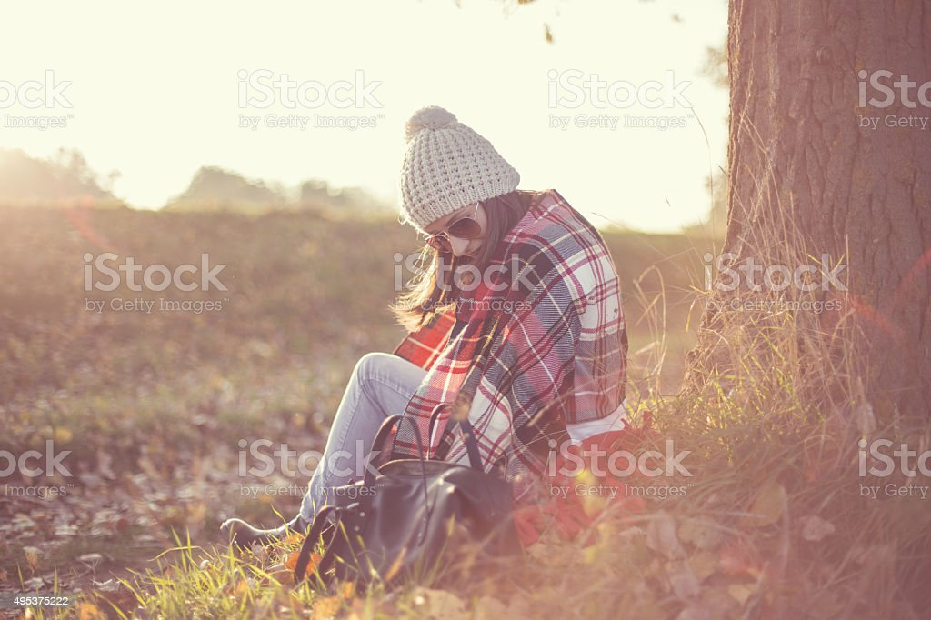 Girl relaxing in nature during autumn stock photo