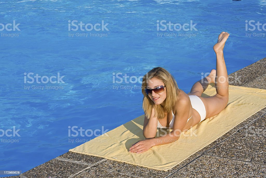 girl relaxing on a swimming pool royalty-free stock photo