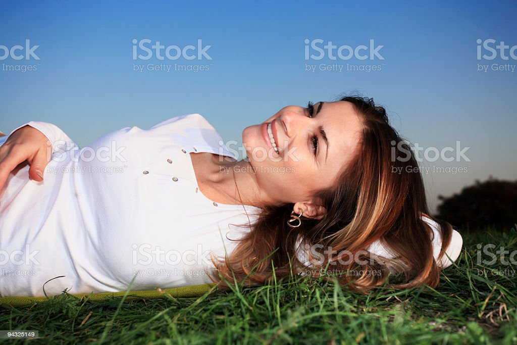 Girl relaxing on meadow royalty-free stock photo