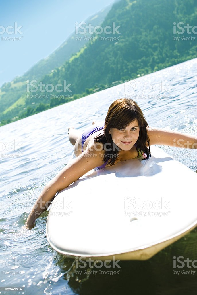 Girl relaxing on surfboard royalty-free stock photo