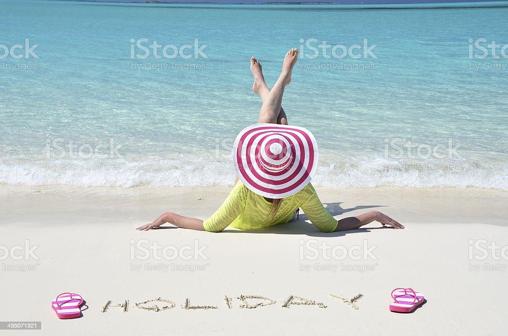 Girl relaxing on the beach of Exuma, Bahamas stock photo