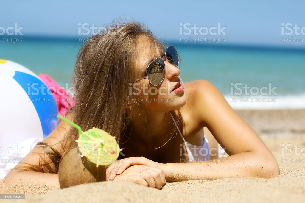 Girl relaxing on the beach royalty-free stock photo