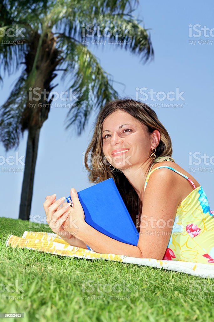 girl relaxing with book royalty-free stock photo