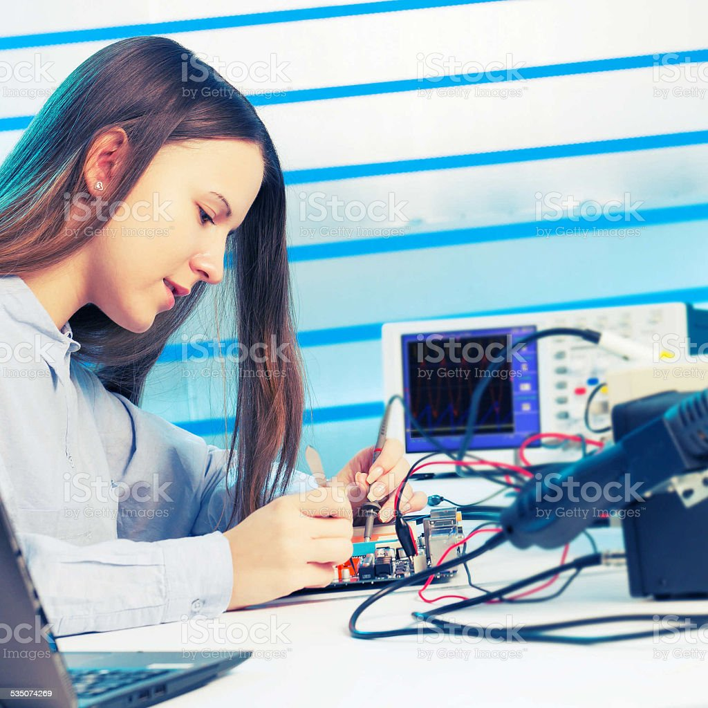 Girl Repairing Electronic Device On The Circuit Board Stock Photo Repair Royalty Free Images Image