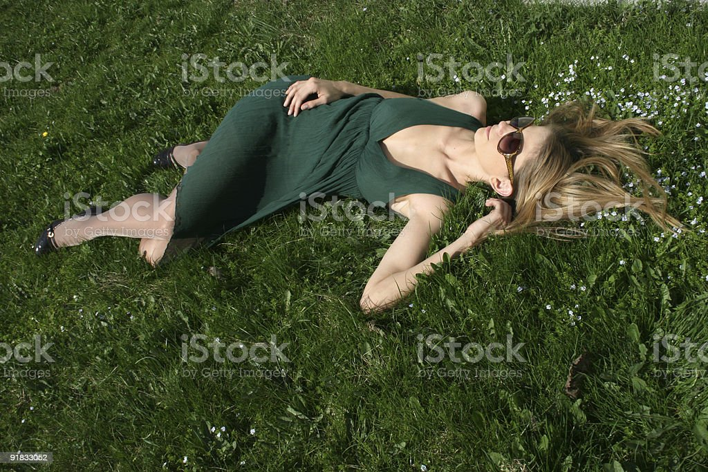Girl resting among flowers royalty-free stock photo