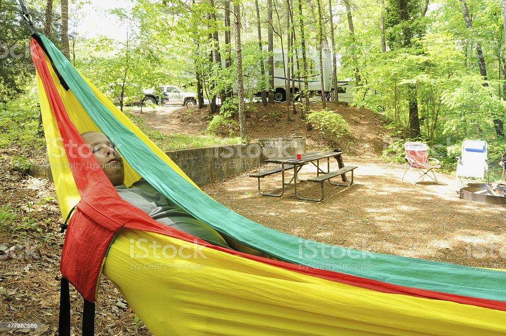 Girl resting in hammock at campground royalty-free stock photo