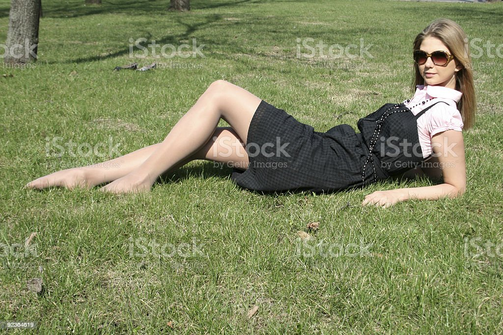 Girl resting on grass royalty-free stock photo