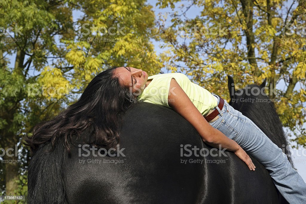 Girl resting on her horse royalty-free stock photo