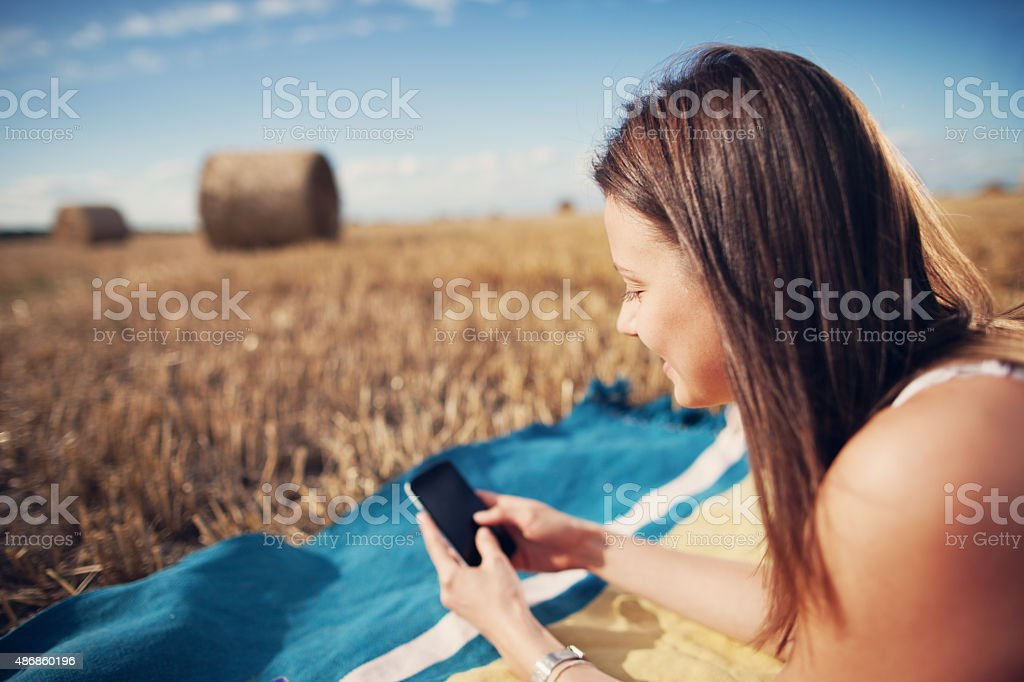 Girl resting with mobile phone in her hands stock photo