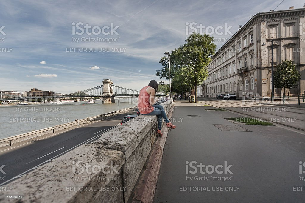 Girl rests alone near the river Danube royalty-free stock photo
