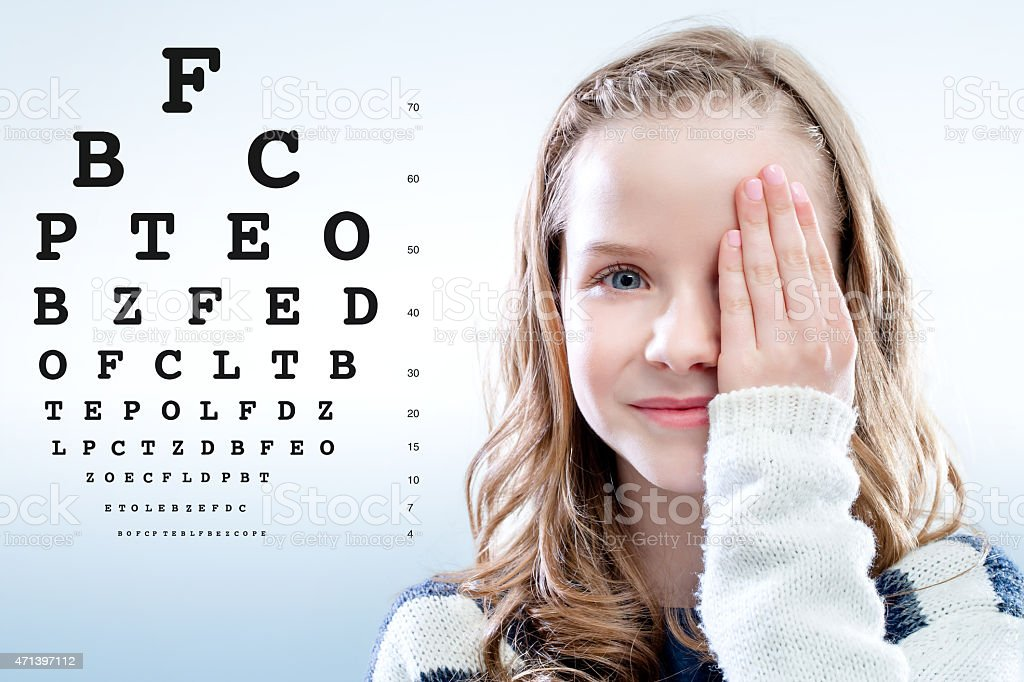 Girl reviewing eyesight. stock photo
