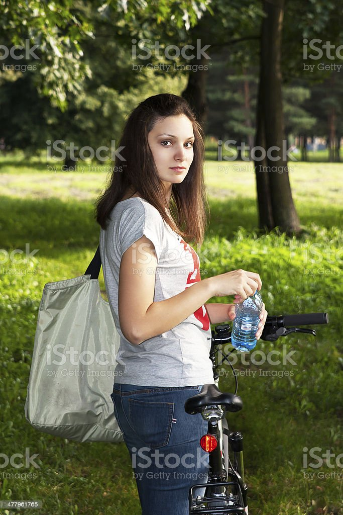 Girl rides a bicycle in the park royalty-free stock photo