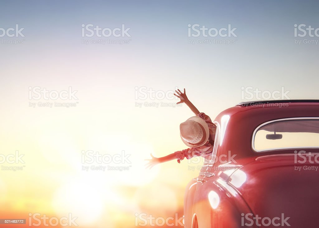 girl rides into the sunset stock photo