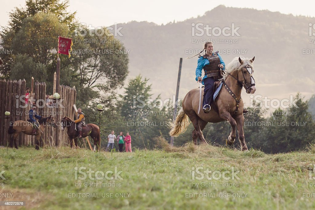 Girl ridind a horse on Tustan' festival in Urych, Ukraine stock photo