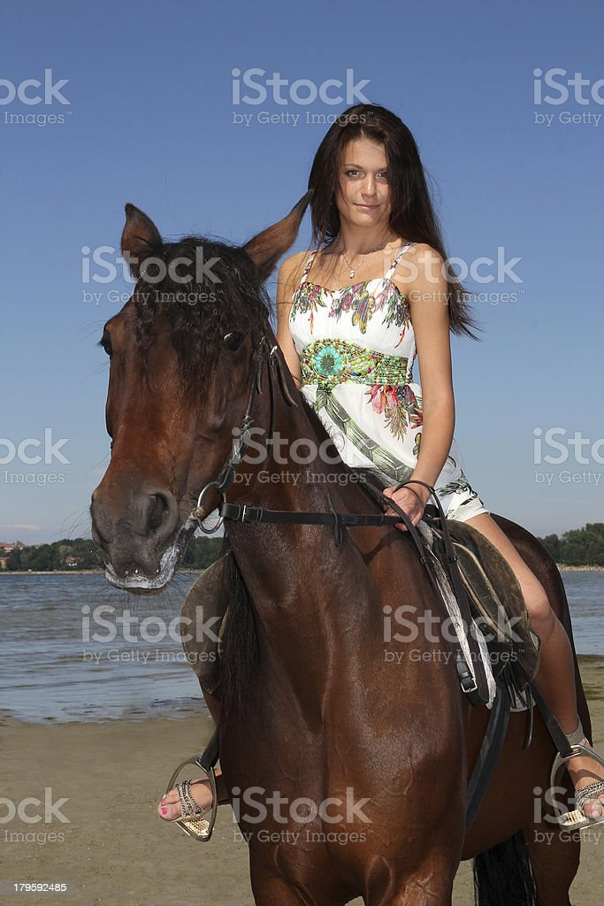 girl riding a horse royalty-free stock photo