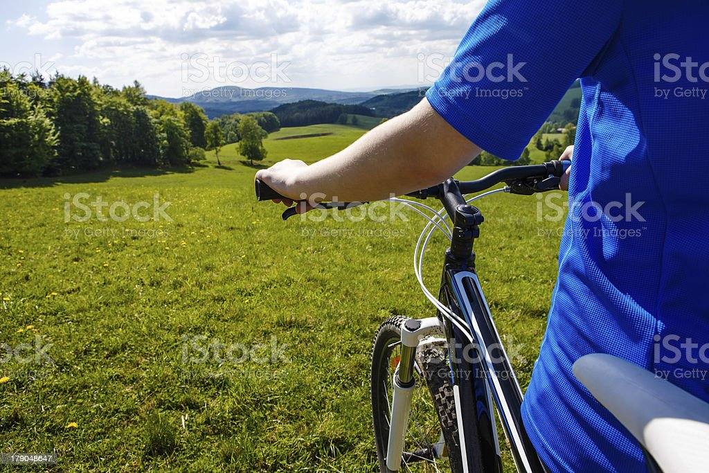 Girl riding bike on forest trails royalty-free stock photo