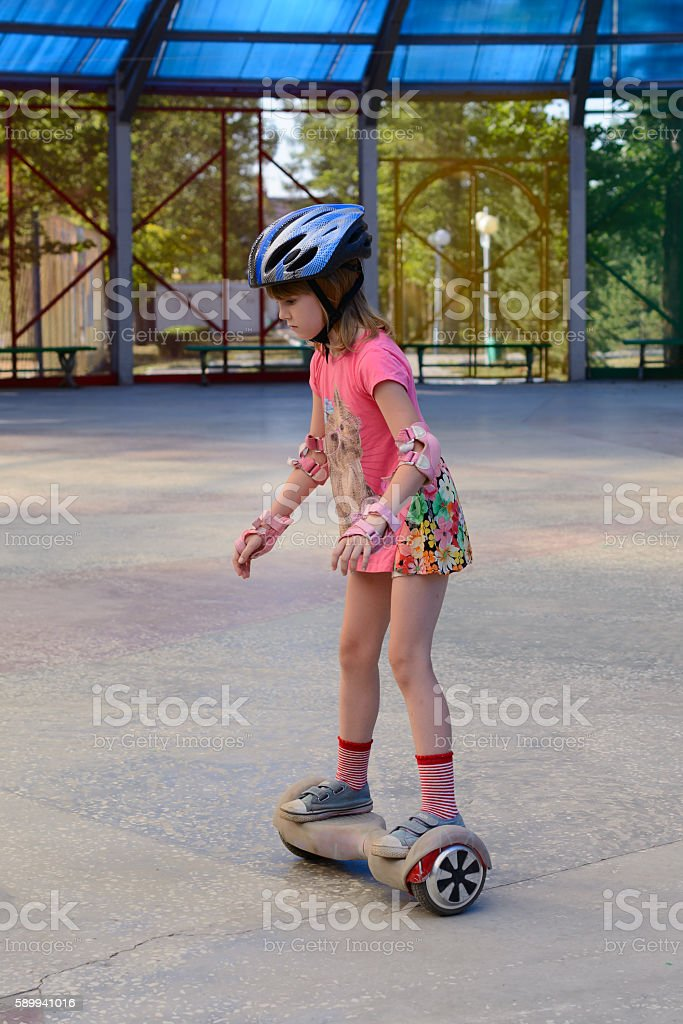 Girl riding on the hoverboard stock photo