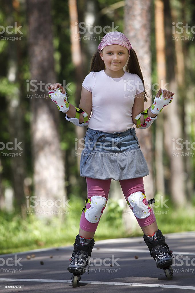 Girl riding rollerblades royalty-free stock photo