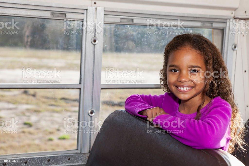 Girl riding school bus royalty-free stock photo