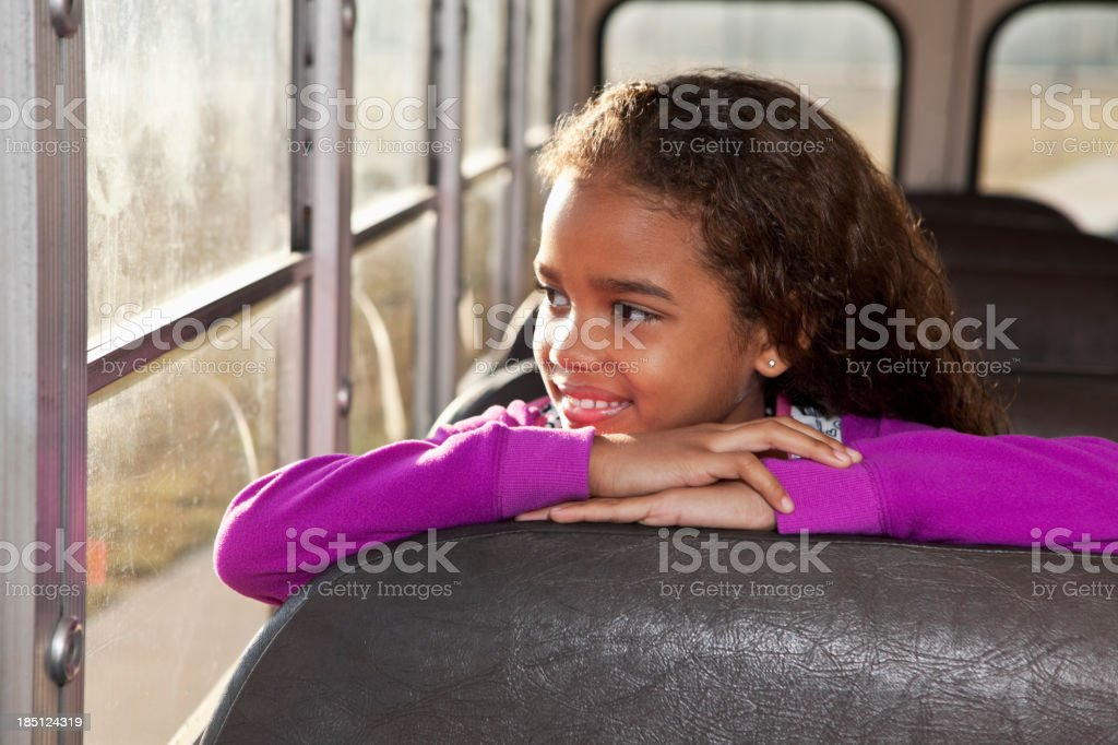 Girl riding school bus royalty-free stock photo