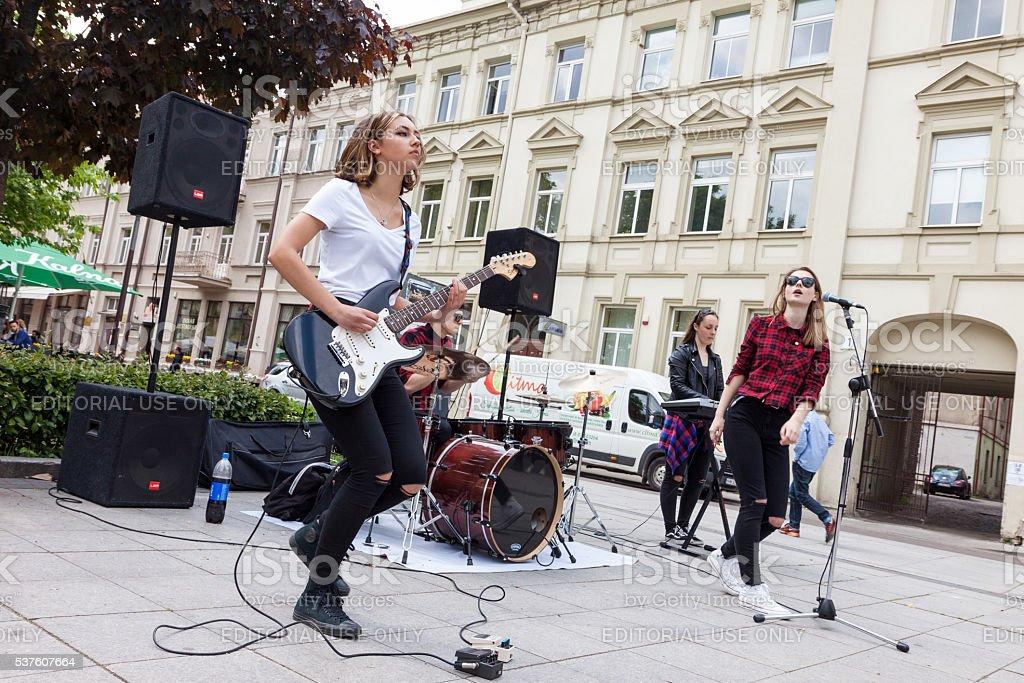 Girl rock band performing stock photo