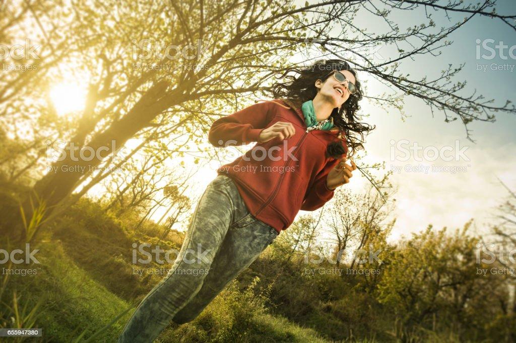 Girl running alone in nature and enjoying fresh air. stock photo