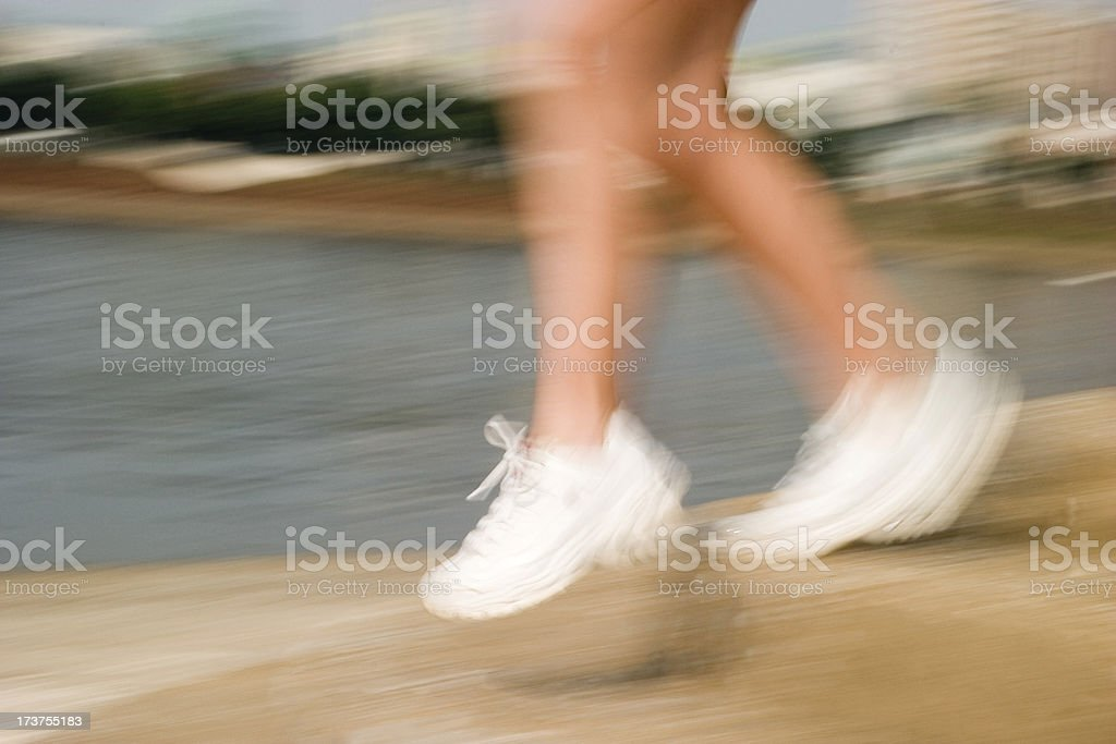 Girl running down steps stock photo