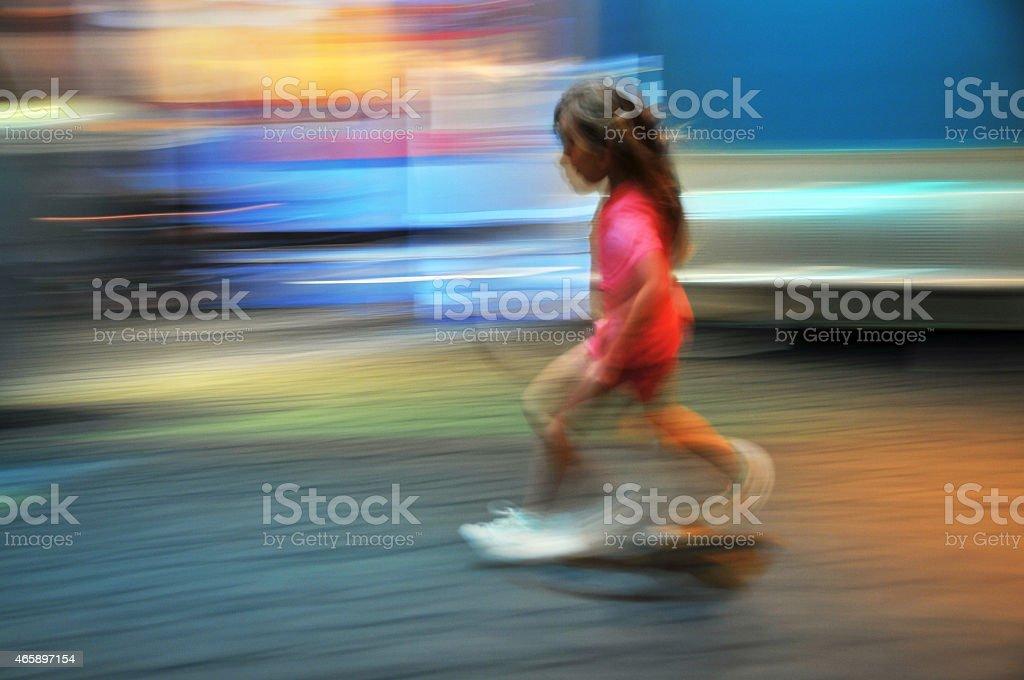 Girl running fast stock photo