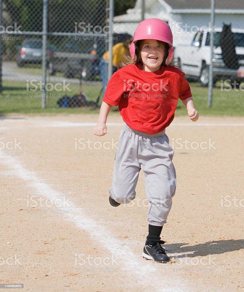Girl running in baseball stock photo