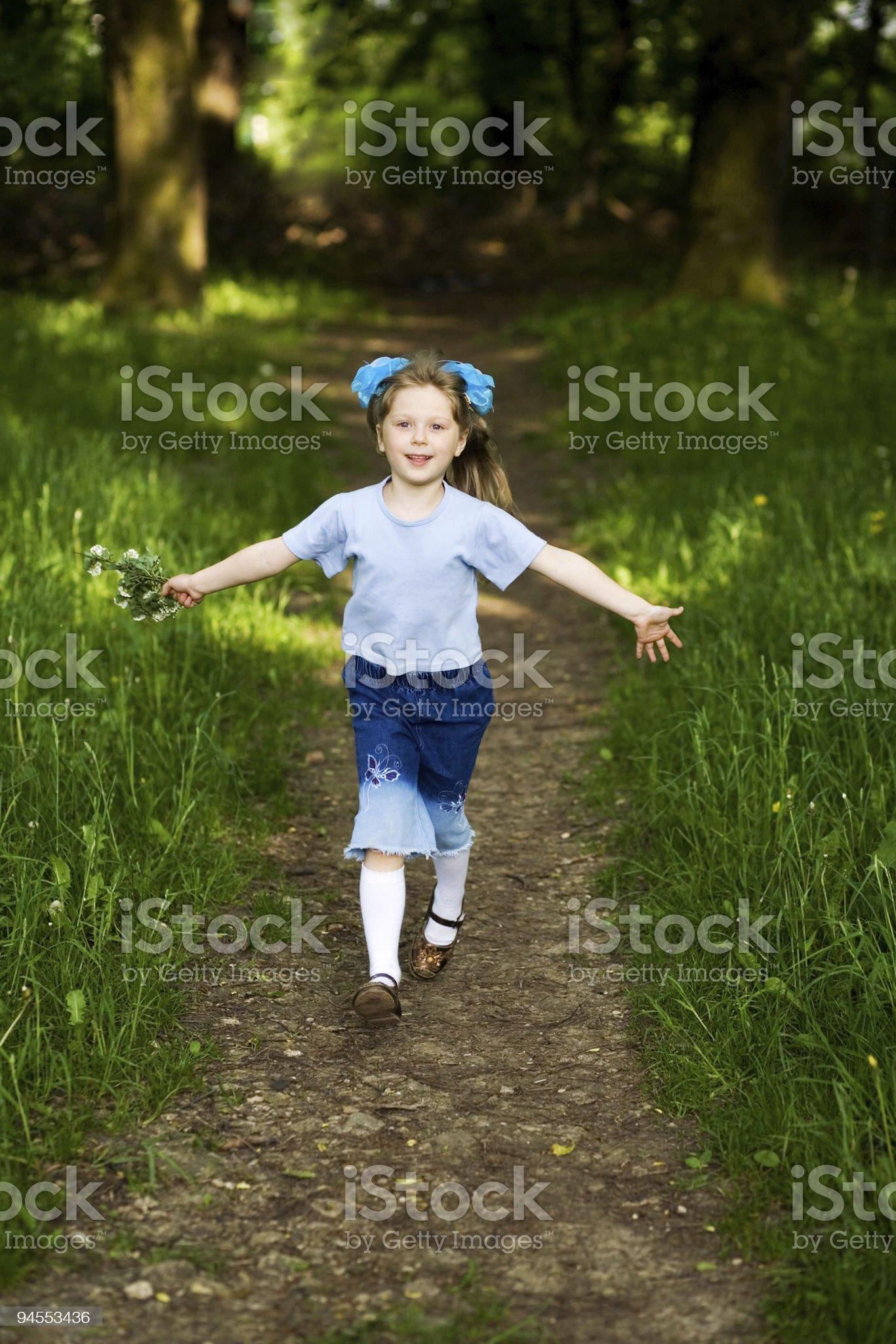 Girl running in park royalty-free stock photo