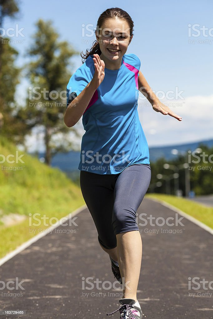 Girl running, jumping outdoor against blue sky royalty-free stock photo