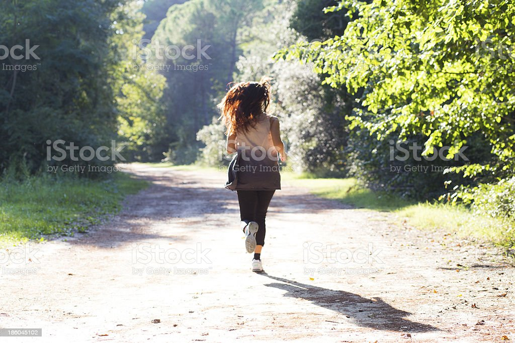 Girl Running on Forest Trail royalty-free stock photo