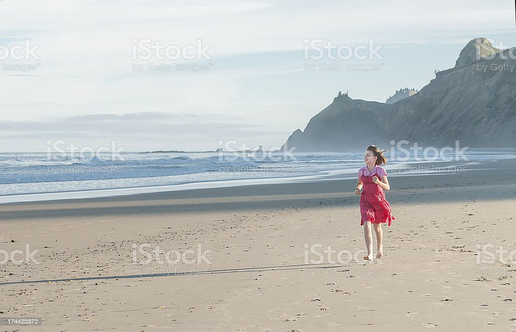 Girl Running on the Beach royalty-free stock photo