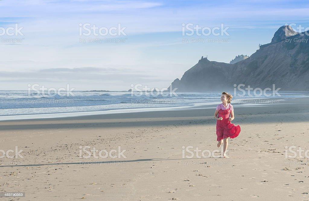 Girl Running on the Beach royalty-free stock photo