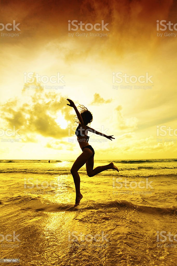Girl running on the beach. royalty-free stock photo