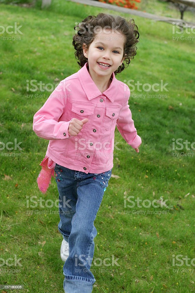 Girl Running Through Grass royalty-free stock photo