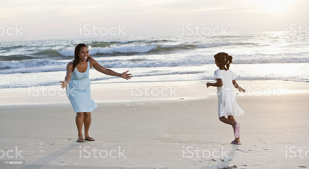Girl running to mother on beach royalty-free stock photo