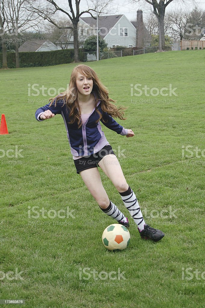 Girl Running With Ball royalty-free stock photo