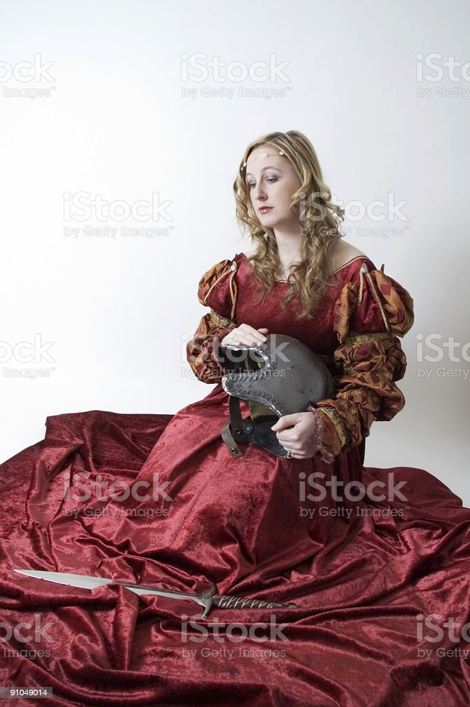 Girl sad looking at soldiers gear royalty-free stock photo