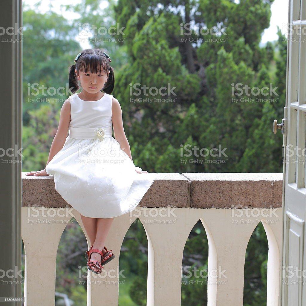 Girl sat on the balcony royalty-free stock photo