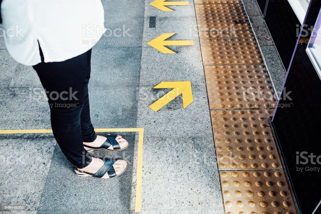 girl satnding on metro train stock photo