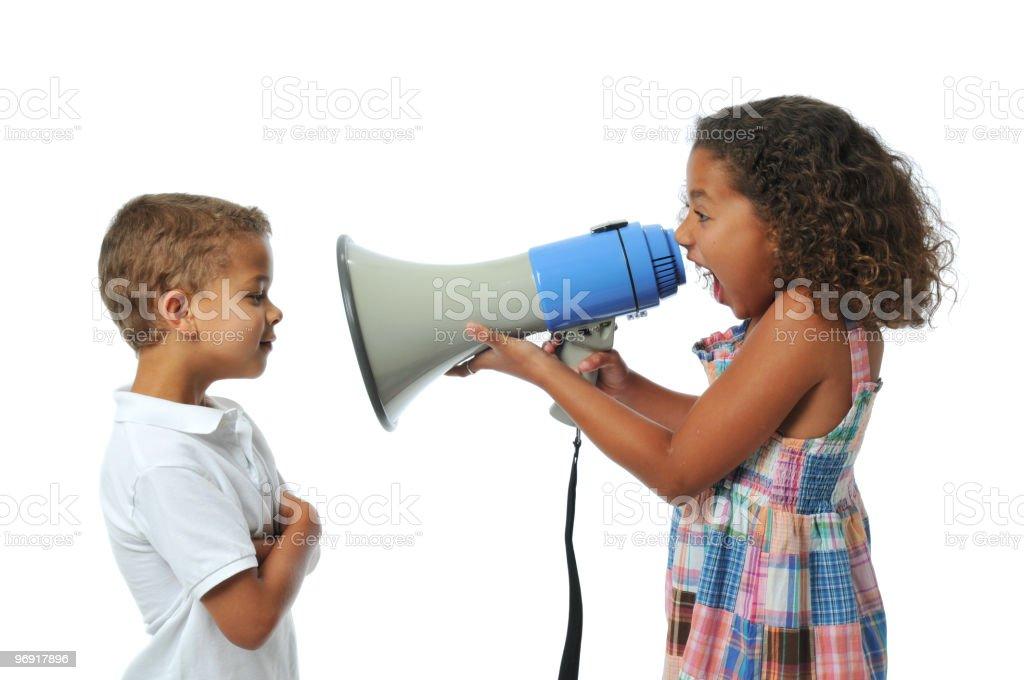 Girl screaming at boy stock photo