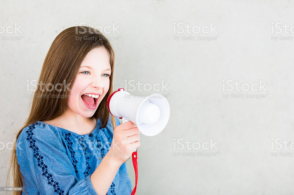 Girl screaming with megaphone royalty-free stock photo