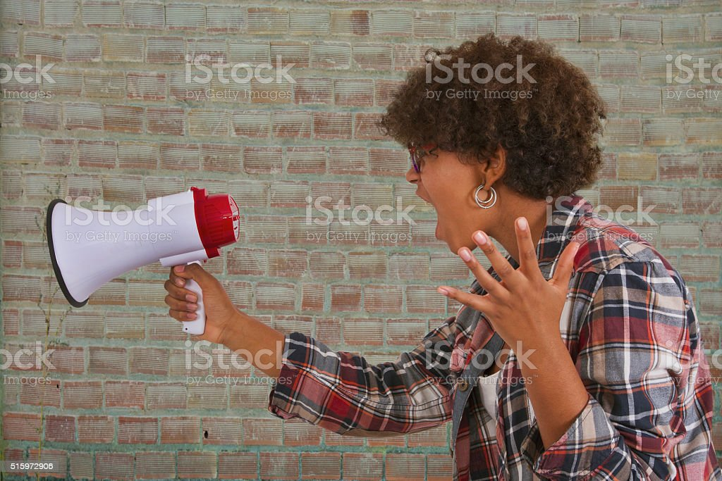 girl screaming with megaphone stock photo