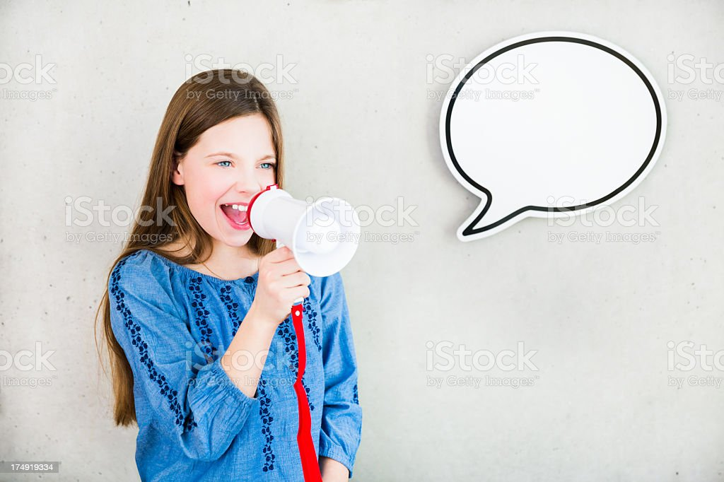 Girl screaming with speech bubble royalty-free stock photo