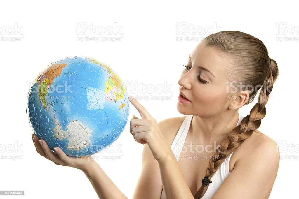 Girl searching on a globe of the world royalty-free stock photo
