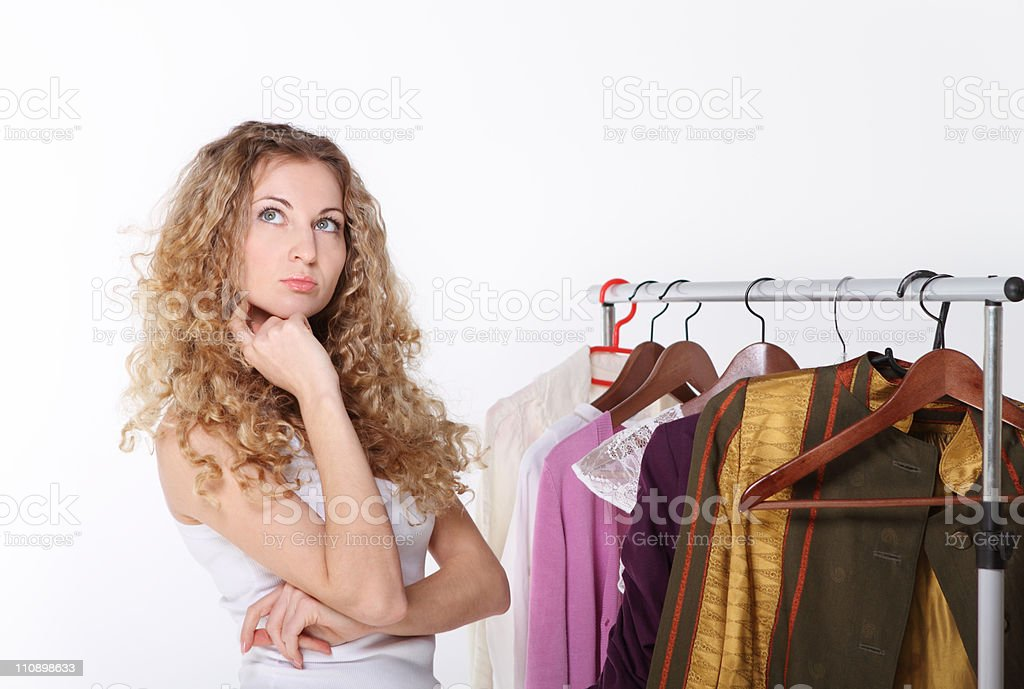 Girl selecting clothes in shop royalty-free stock photo