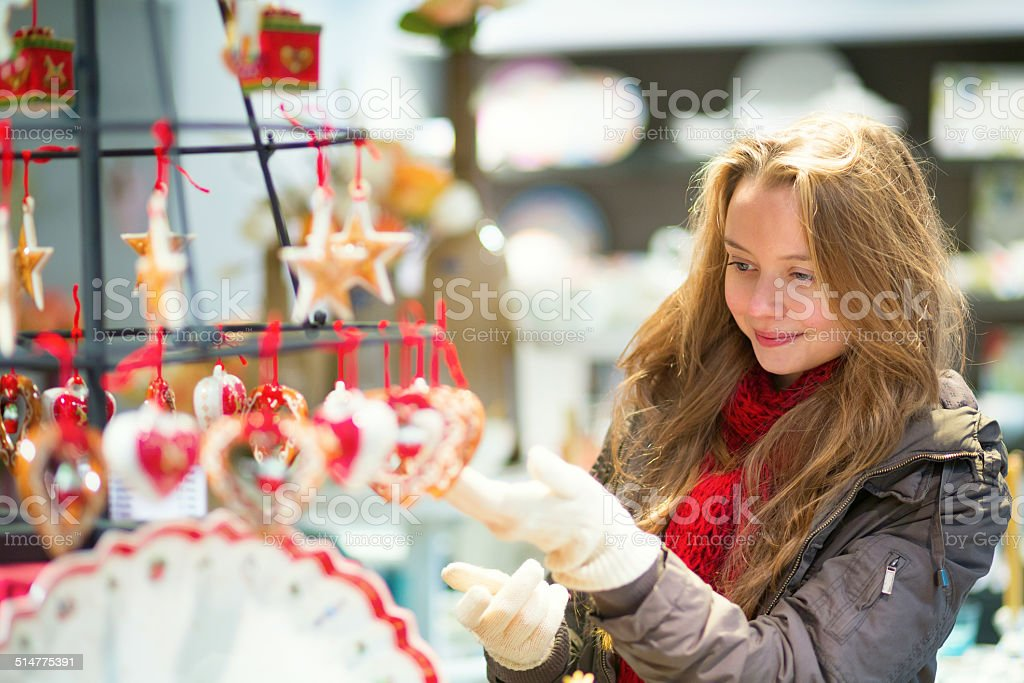 Girl selecting decoration on a Christmas market stock photo
